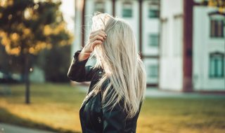 blonde-woman-playing-with-hair-against-sun-picjumbo-com