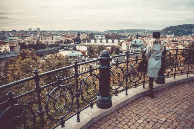 woman-looking-over-the-autumn-prague-picjumbo-com