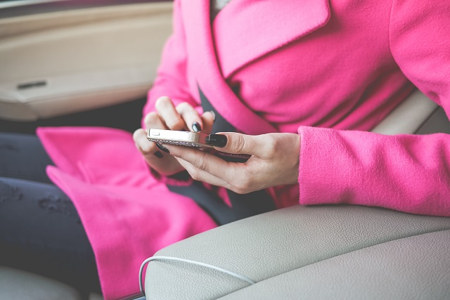 nicely-dressed-woman-using-her-phone-in-a-car-picjumbo-com