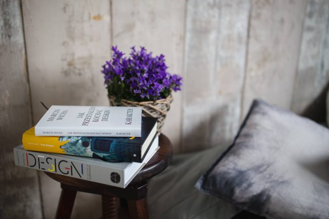 kaboompics_Books and purple flowers on a wooden stool by the bed