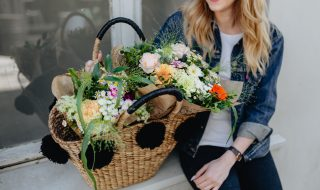 kaboompics_Young woman with basket full of flowers (1)
