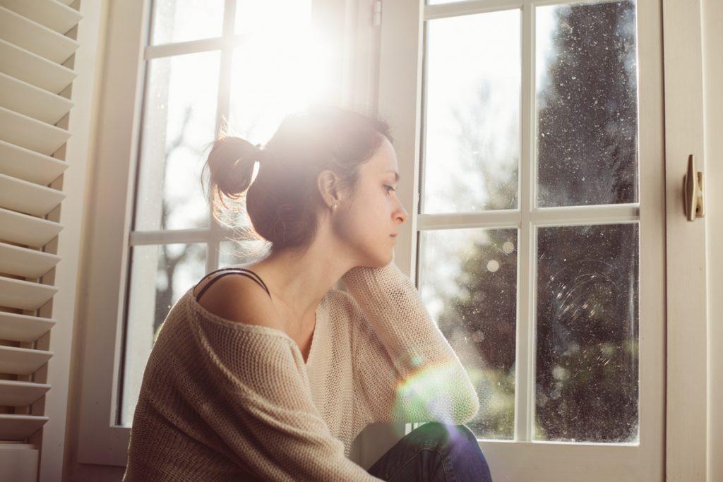Unhappy-housewife-sitting-near-the-window-635960240_1257x838