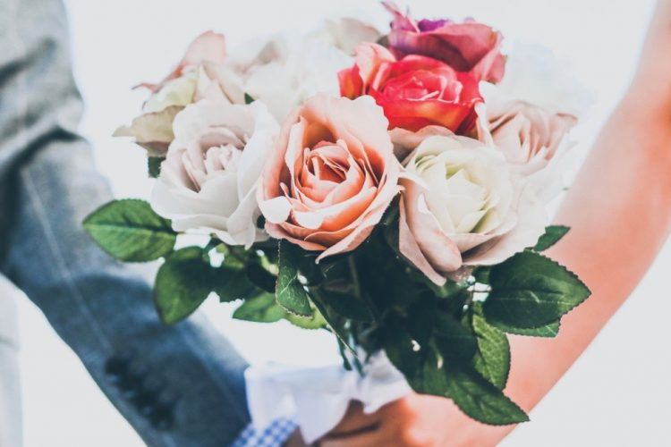 Two couple have bouquet in the morning