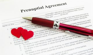 prenuptial agreement with two red hearts