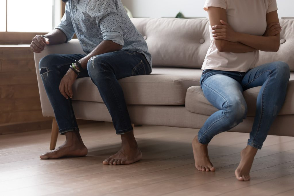 Black couple sit separately avoid talking after fight