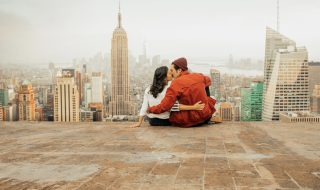 Rear view of couple embracing in New York