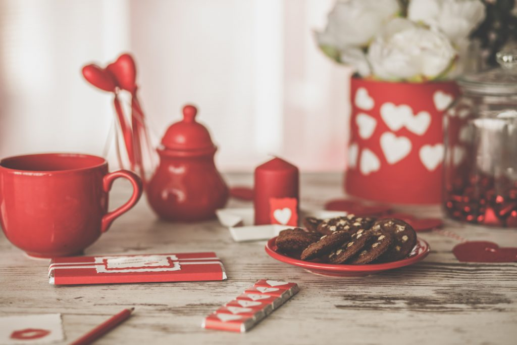 Arrangement of sweets and love notes for Valentine's day