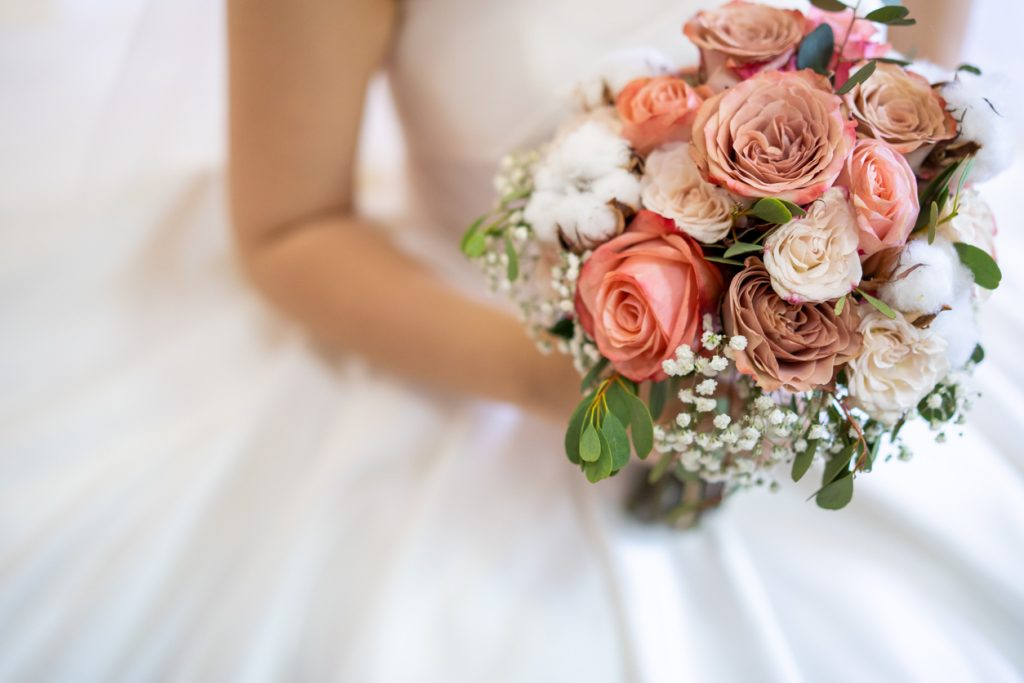 Asian bride with flower bouquet