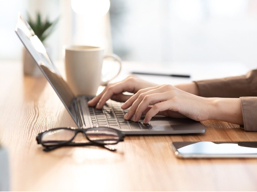 woman-using-her-personal-computer-at-cafe-picture-id1202921639