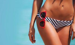 woman-in-bikini-and-sunglasses-picture-id1047665252